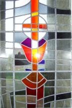 stained glass window depicting The Holy Eucharist